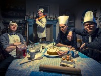 Portrait. A band pose as chefs in a low key picture as they appear to be baking a cake
